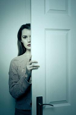 Miguel Sobreira STARING WOMAN BEHIND DOOR IN HOME Women