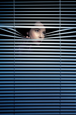 Miguel Sobreira Woman Peering From Behind Blinds