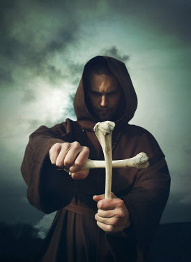 Mark Owen PRIEST MAKING CRUCIFIX OF BONES OUTDOORS Men
