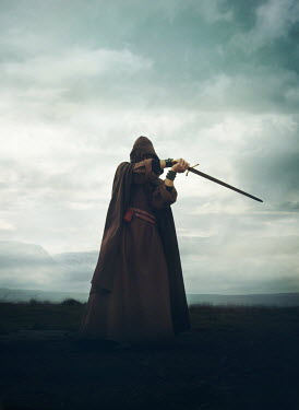 Mark Owen MAN WITH HOODED CAPE AND SWORD OUTDOORS Men