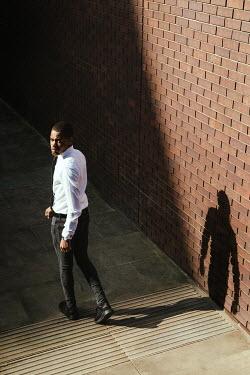 Matilda Delves WORRIED MAN WALKING IN SHADOW IN CITY Men