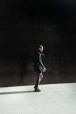 Matilda Delves MAN IN JACKET WALKING IN CITY Men