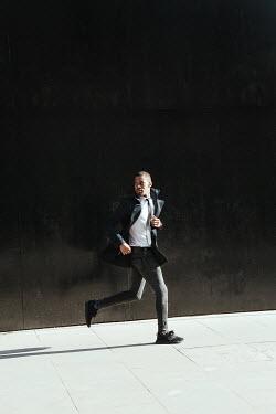 Matilda Delves WORRIED MAN RUNNING IN CITY Men