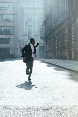 Matilda Delves MAN RUNNING IN URBAN SUNLIT STREET Men