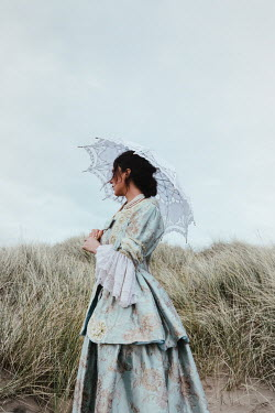 Matilda Delves HISTORICAL WOMAN BY SAND DUNES WITH PARASOL Women