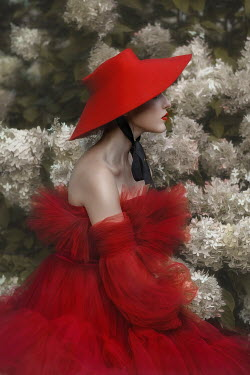 Beata Banach WOMAN IN RED HAT AND GOWN BY WHITE FLOWERS Women