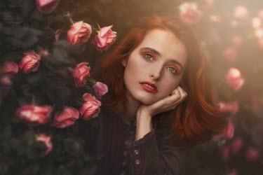 Beata Banach WOMAN WITH RED HAIR BY PINK ROSE BUSH Women