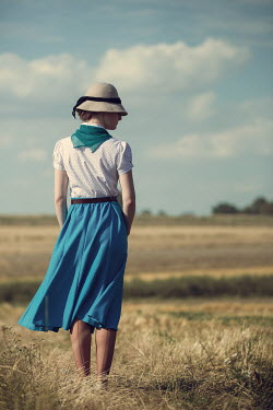 Magdalena Russocka retro woman wearing hat standing in countryside