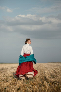 Magdalena Russocka historical woman with shawl walking in countryside