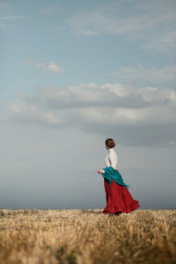 Magdalena Russocka historical woman with shawl standing in countryside