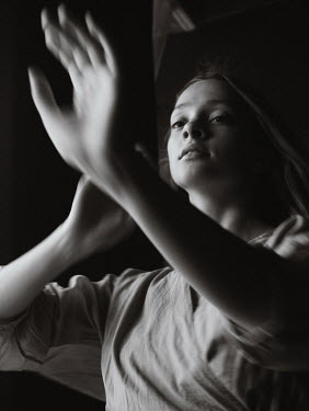 Marta Syrko YOUNG GIRL WITH RAISED HANDS IN SHADOW Women