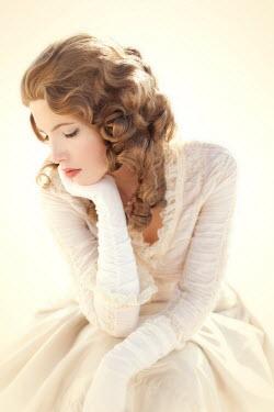 ILINA SIMEONOVA SAD WOMAN IN WHITE SITTING THINKING Women