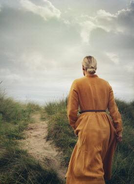 Mark Owen BLONDE WOMAN WALKING ON SANDY PATH Women