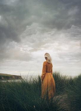 Mark Owen BLONDE WOMAN IN SAND DUNE WATCHING SEA Women