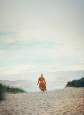Mark Owen BLONDE WOMAN RUNNING IN DESERT Women