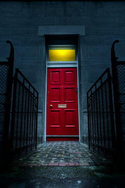 Magdalena Russocka red door of historical townhouse at night