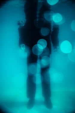 Magdalena Russocka man in suit standing under water