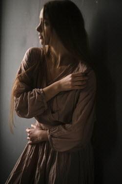 Marta Syrko ANXIOUS GIRL WITH LONG DARK HAIR IN SHADOW Women