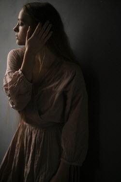 Marta Syrko DREAMY GIRL WITH DARK HAIR STANDING IN SHADOW Women