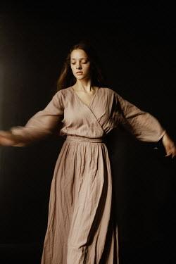 Marta Syrko SERIOUS GIRL IN COTTON DRESS DANCING Women