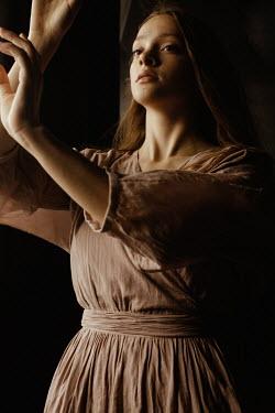 Marta Syrko GIRL WITH RAISED HANDS DANCING IN SHADOW Women