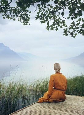 Mark Owen BLONDE GIRL SITTING ON JETTY WATCHING LAKE Women