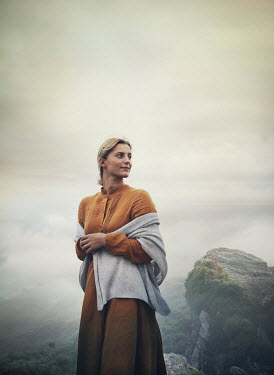 Mark Owen WOMAN WITH SHAWL ON CLIFF IN MISTY COUNTRYSIDE Women