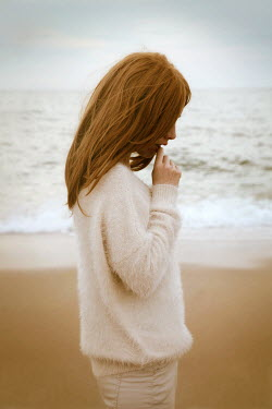 ILINA SIMEONOVA THOUGHTFUL WOMAN IN SWEATER ON BEACH Women