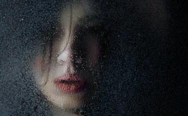 Kirill Sakryukin WOMAN BEHIND WET WINDOW IN SHADOW Women
