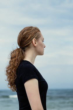 Magdalena Russocka close up of modern woman standing by sea
