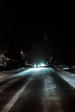 Magdalena Russocka cars on road in blizzard at night
