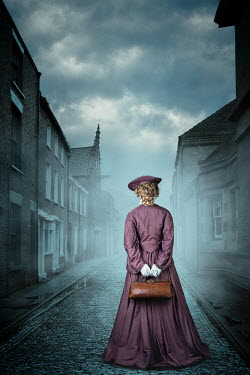 Magdalena Russocka historical woman holding medic bag standing on misty street