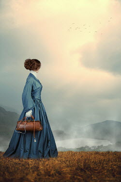 Magdalena Russocka historical woman holding medic bag and stethoscope standing in countryside