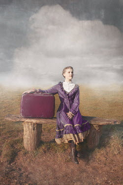 Anna Buczek GIRL WITH SUITCASE SITTING IN COUNTRYSIDE Children