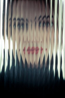 Ildiko Neer woman staring behind distorted glass