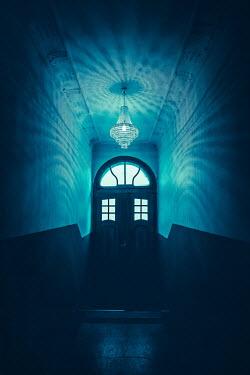Joanna Czogala DOOR HALLWAY AND CHANDELIER AT NIGHT Interiors/Rooms
