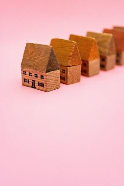 Laura Ranftler ROW OF MINIATURE WOODEN HOUSES Miscellaneous Objects