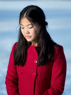 Elisabeth Ansley ASIAN GIRL IN RED COAT OUTDOORS IN SNOW Women