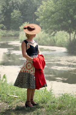 Elisabeth Ansley BLONDE RETRO WOMAN IN HAT BY RIVER IN SUMMER Women
