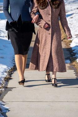Elisabeth Ansley TWO RETRO WOMEN ARM IN ARM ON SNOWY PATH Women