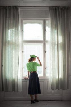 Ildiko Neer Retro woman standig at window