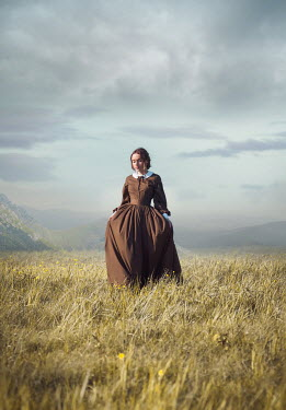 Joanna Czogala HISTORICAL BRUNETTE WOMAN IN FIELD WITH HILLS Women