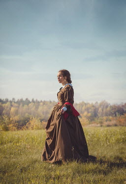 Joanna Czogala HISTORICAL WOMAN STANDING IN COUNTRYSIDE Women