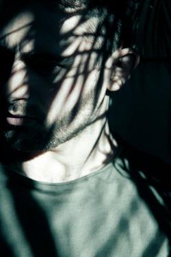 Miguel Sobreira MAN IN SHADOW OF PLANT Men