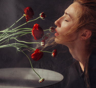 Marta Syrko WOMAN WITH RED HAIR SMELLING FLOWERS INDOORS Women