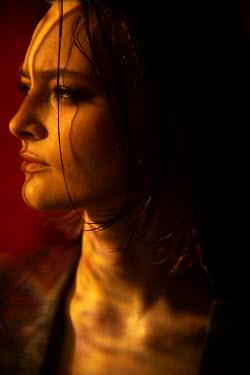 Marta Syrko SERIOUS WOMAN IN GOLDEN LIGHT Women