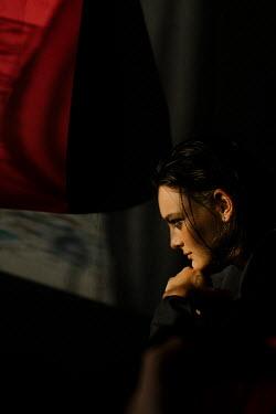 Marta Syrko SERIOUS GIRL SITTING IN SHADOW INDOORS Women