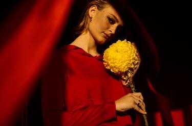 Marta Syrko WOMAN IN RED HOLDING YELLOW FLOWER Women