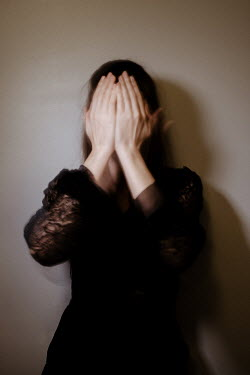 Esme Mai Woman covering face with hands