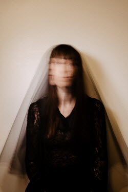 Esme Mai Long exposure of woman in veil shaking head